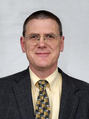 Curtis W. Ollayos, MD